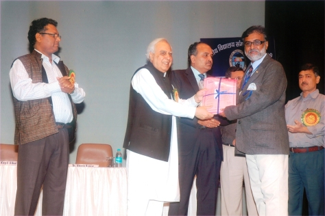 KVS National Incentive Award 2011 from Shri Kapil Sibal,Hon'ble Minister of Human Resources & Development Government of India & Chairman KVS in New Delhi on 18 November 2011, as Shri Avinash Dikshit, Commissioner KVS and Shri U.N.Khaware , Joint Commissioner (Acad) looks on...