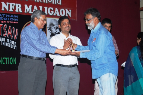 Receiving the trophy and Certificate of Appreciation from Shri A.K.Vajpayee, Assistant Commissioner Kendriya Vidyalaya Sangathan, Regional Office Guwahati on 19 April 2011, for being the Co-ordinator (Book Review), KVS Tagore Mahotsav.